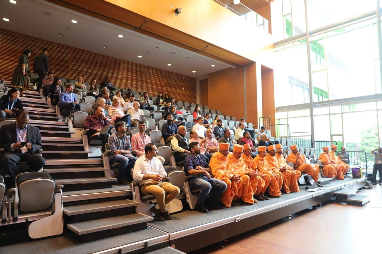 Scholars listening to paper presentations in the Akshar Purushottam Darshanam session.