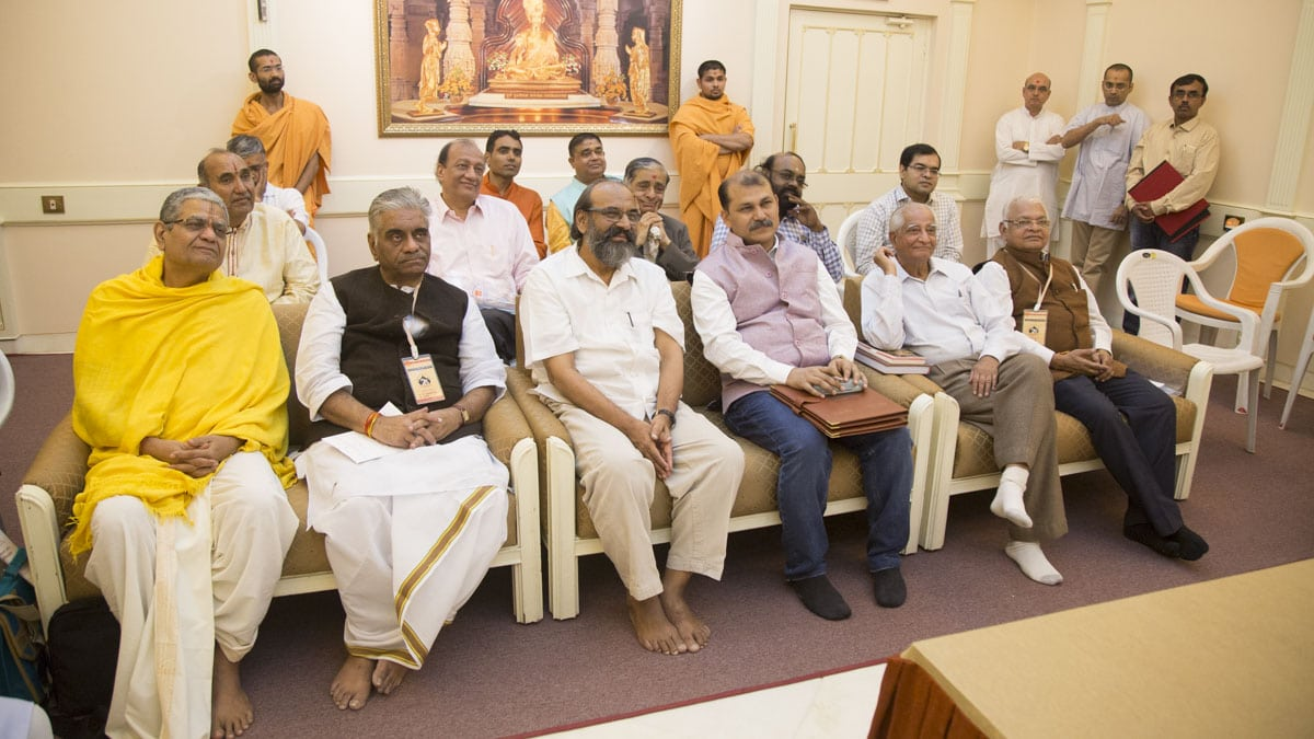 Scholars during the meeting with HH Mahant Swami Maharaj and senior swamis