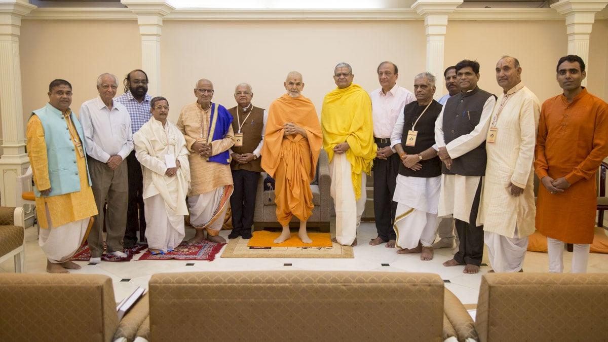 Scholars with HH Mahant Swami Maharaj