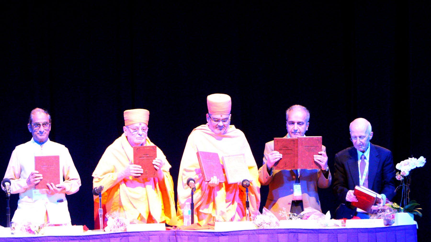 Bhagwan Swaminarayan's Akshar-Purushottam Darshan being recognized as distinct Vedanta tradition at the World Sanskrit Conference. Seen from Left to Right - V. Kutumba Shastry (President, International Association of Sanskrit Studies. Head of Organizing Committee of World Sanskrit Conference), Sadguru Pujya Ishwarcharan Swami, Mahamahopadhyaya Bhadreshdas Swami, Prof. Ashok Aklujkar (Member World Sanskrit Conference Secretariat), Prof. George Cardona (University of Pennsylvania)