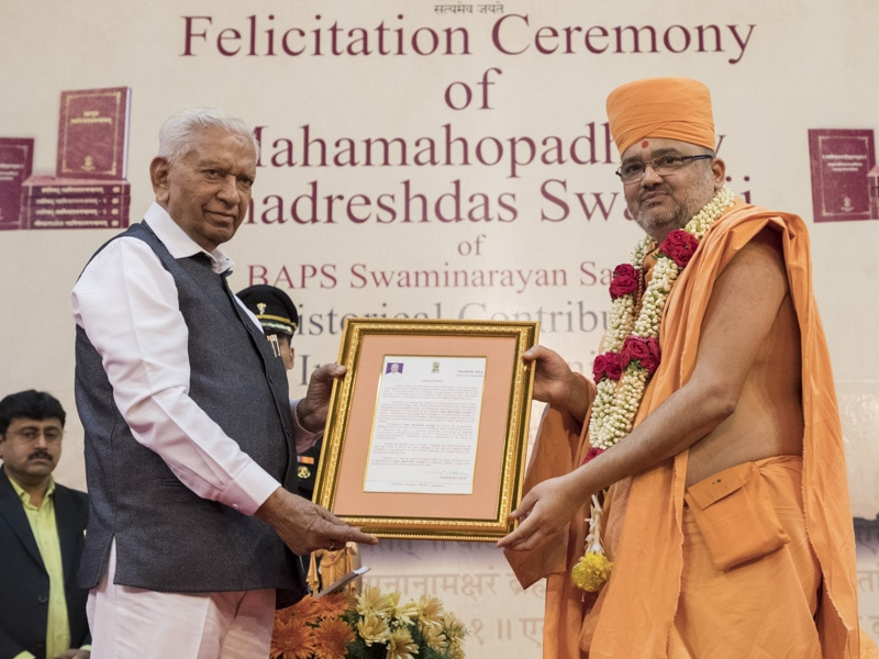 The Governor of Karnataka, His Excellency Vajubhai Vala, felicitates Bhadreshdas Swami