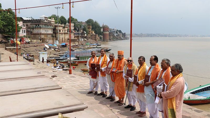 A group of distinguished scholars venerate the text at the holy banks of Ganga in Varanasi